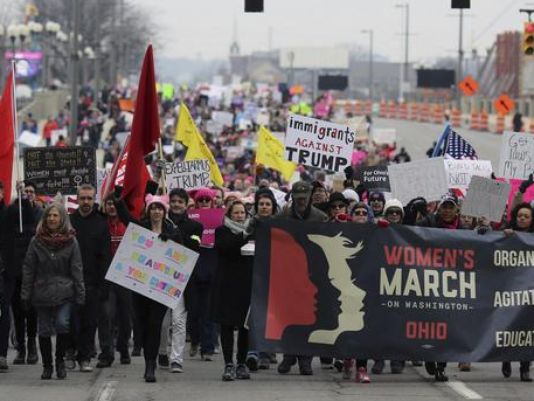 In Cincinnati, marchers hold signs with slogans