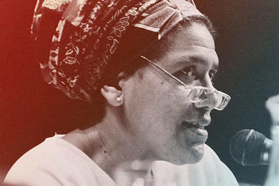 Audre Lorde reading at the International Feminist Book Fair in London, 1984. Photo by Dagmar Schultz.