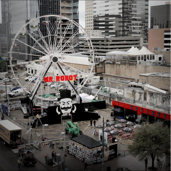 a giant ferris wheel in austin for sxsw is branded with mr. robot's face