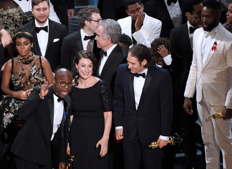 shocked cast and producers of Moonlight on Oscars stage
