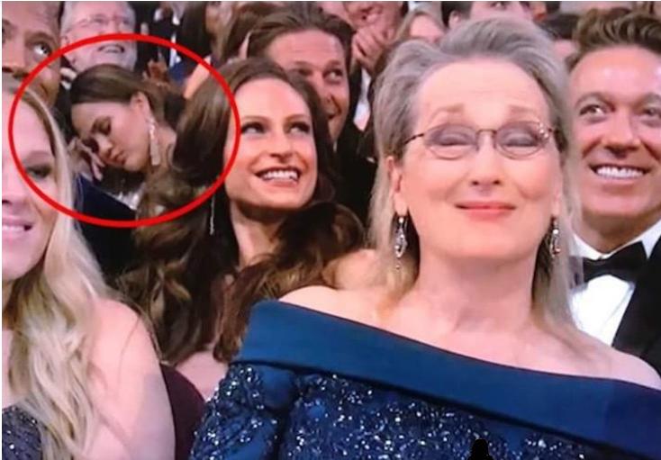 Meryl Streep in foreground, sleeping Chrissy Teigen behind her