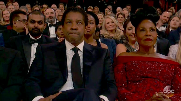 Denzel Washington frowns from his Oscars seat