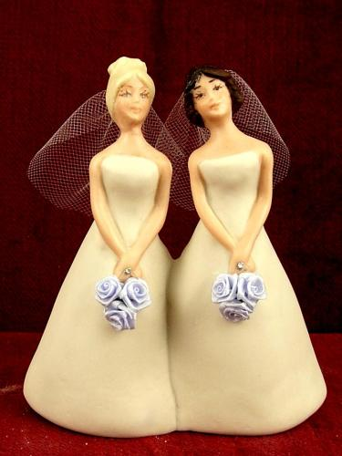 A photo of wedding-cake topper of two brides