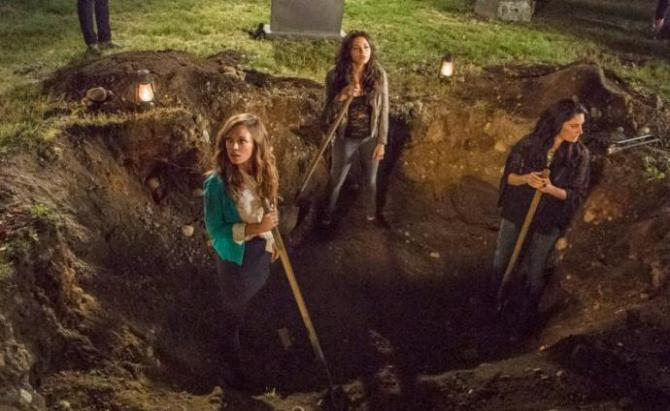 the daughters and mom standing in a giant grave