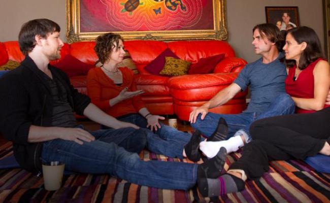 two couples sit in a living room