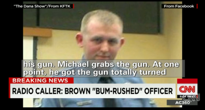 a still from anderson cooper's show has a caller saying michael brown grabbed the officer's gun