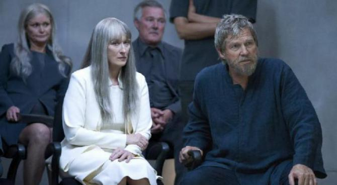 meryl streep has long grey hair, a white suit, and a cold stare as the Chief Elder in The Giver