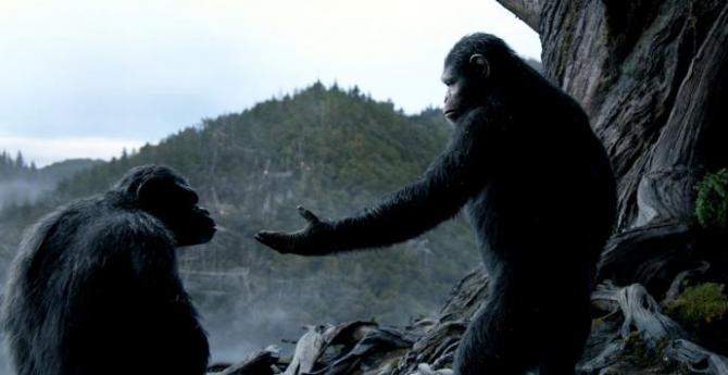 an apes gesturing to another ape in planet of the apes