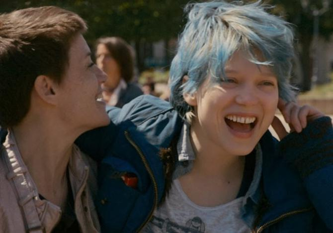 a still from blue is the warmest color shows two girls smiling