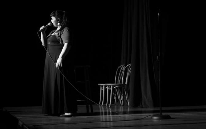 comedian bri pruett alone onstage at the all jane no dick comedy festival