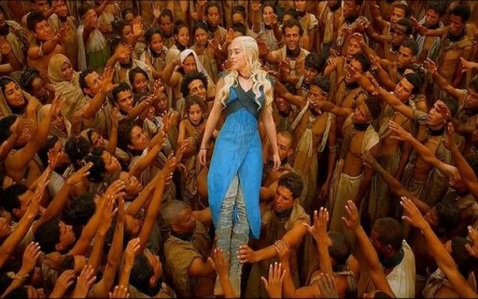 Daenerys Targaryen, surrounded by people of color who are freed slaves