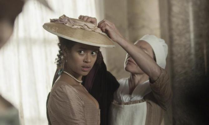 gugu mbatha-raw in a fancy dress and hat in Belle