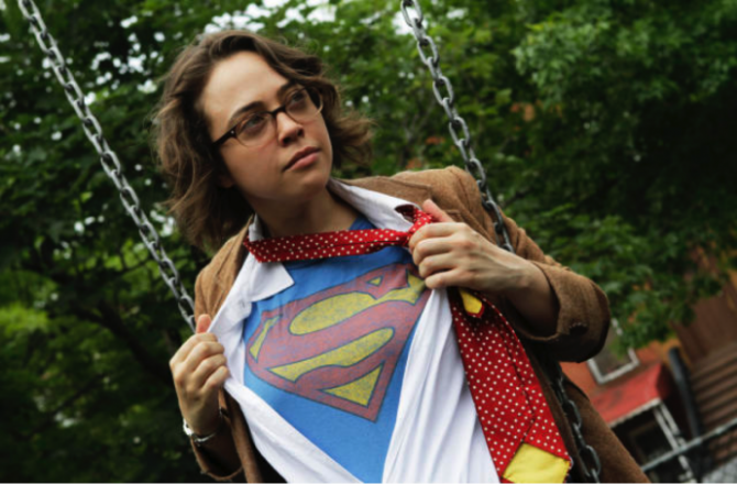 comedian janine brito, wearing a superman S under her clothes