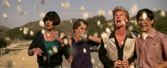 a scene from real genius shows the cast with popcorn falling from the sky