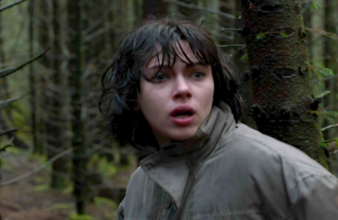 Johansson's character, looking terrified in the woods