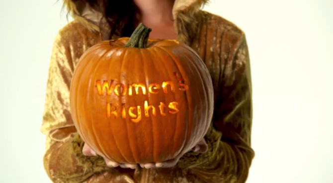 "a pumpkin carved with ""women's rights"""