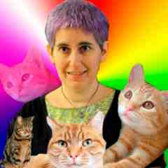 Photo of white woman with purple hair with rainbow background and tabby cats all around her