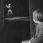 Carrie Fisher watches her mother, Debbie Reynolds, from backstage
