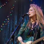 meryl streep onstage with a guitar in ricki and the flash