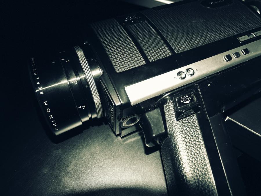 An 8mm camera, seen in dim lighting