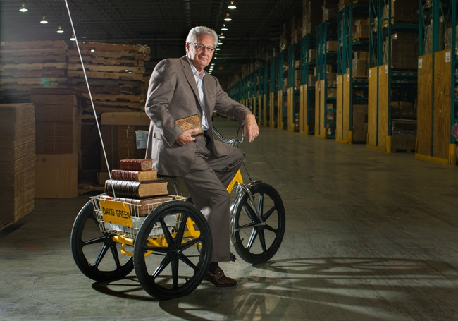 a portrait of david green on an adult trike hauling bibles
