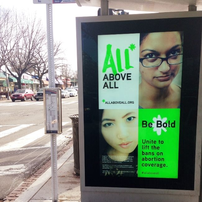 a bus ad for the all above all campaign