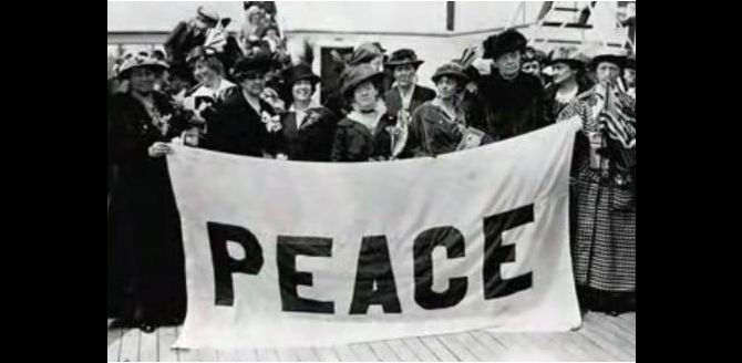 "A group of mothers holds a sign reading ""peace"""