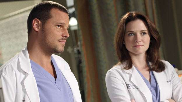 Doctor Karev and Doctor Kepner in a patient's room.