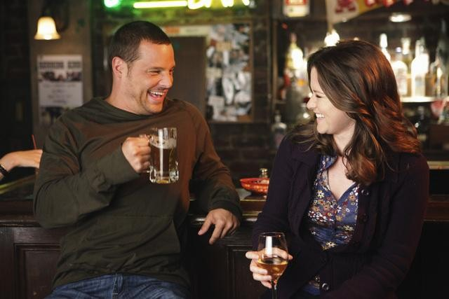 Dr. Karev and Dr. Kepner, drinking in a bar.