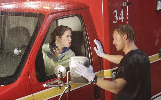 Dr. Kepner, in the driver's seat of an an ambulance, screaming at Dr. Hunt. Rain pours down.