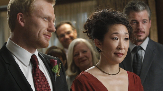 Drs Yang and Hunt at the altar. Both are smiling.