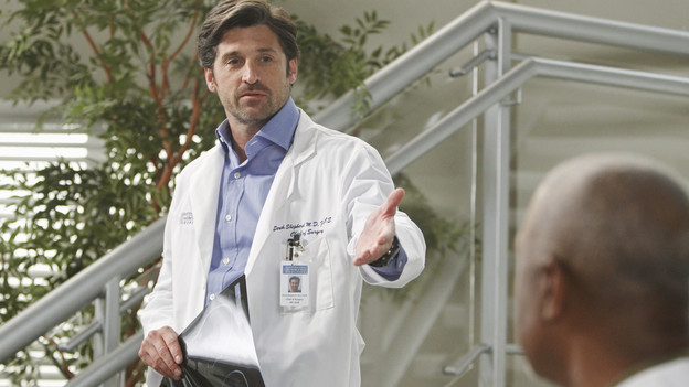 Derek standing on the stairs at the hospital, announcing that he's leaving the chief's position.