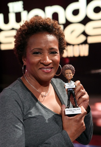 Wanda Sykes with action figure of herself