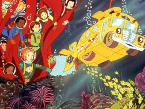 cartoon still from the Magic Schoolbus: a yellow bus drives underwater while Ms Frizzle and her students hang out near a cartoon clump of seaweed wearing diving helmets