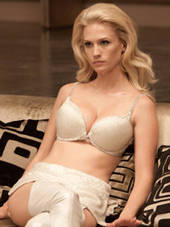 January Jones as Emma Frost: a white woman in a bra and underwear