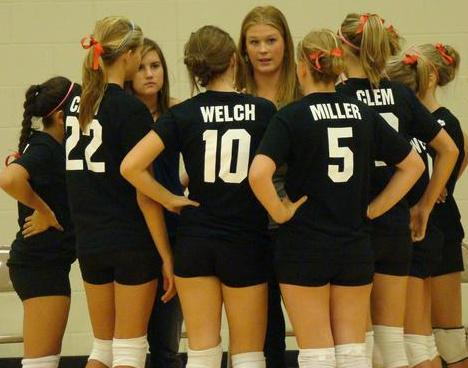 Carly in the huddle with her volleyball team