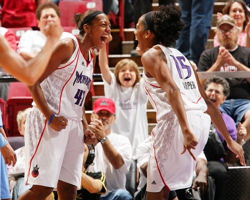 Laura Harper celebrates with her Sacramento Monarchs teammate in 2008